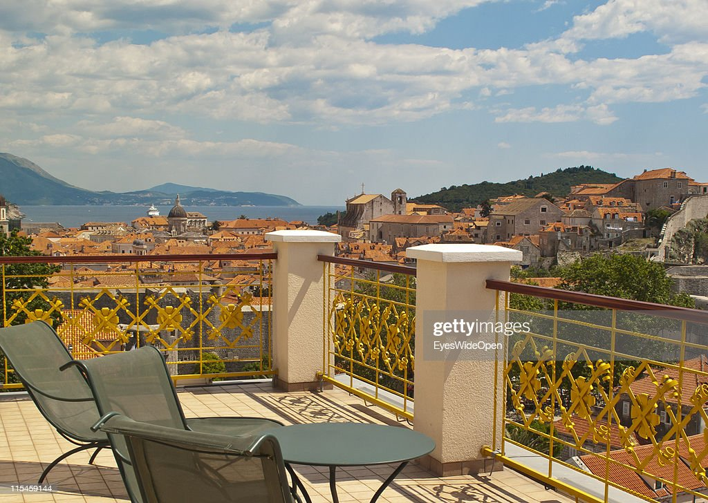 Balcony of the Hilton Imperial Dubrovnik Hotel with view of the UNESCO World Heritage Site city of Dubrovnik on the Dalmatian coast of the Adriatic Sea on May 13, 2011 in Dubrovnik, Croatia. The old town is surrounded by a 1,9 km long city wall and called the Pearl of the Adriatic.