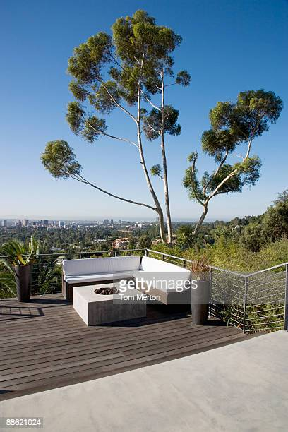Balcony seating area overlooking cityscape