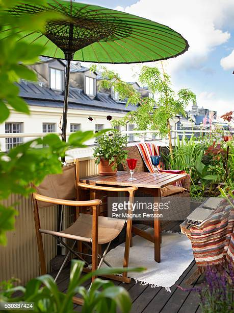 a balcony with a parasol sweden - balkon stock-fotos und bilder