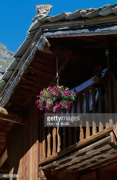Balcony with flowers, Bonneval-sur-Arc, Upper Maurienne, Rhone-Alpes, France.