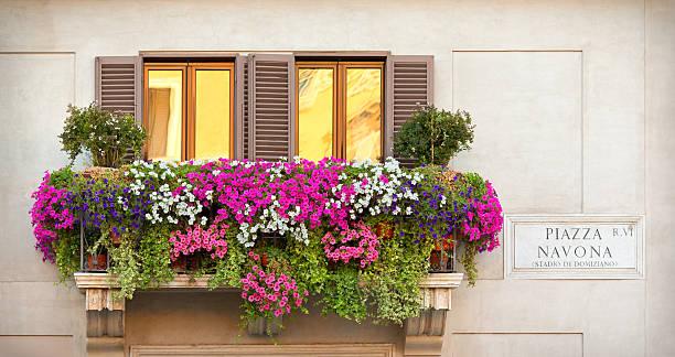balcony with flowers piazza navona rome italy photos com