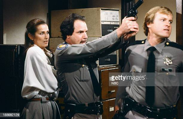 BLUES 'Bald Ambition' Episode 704 Pictured Veronica Hamel as Joyce Davenport Howard Schecter as First Bailiff Steven Barr as Second Bailif