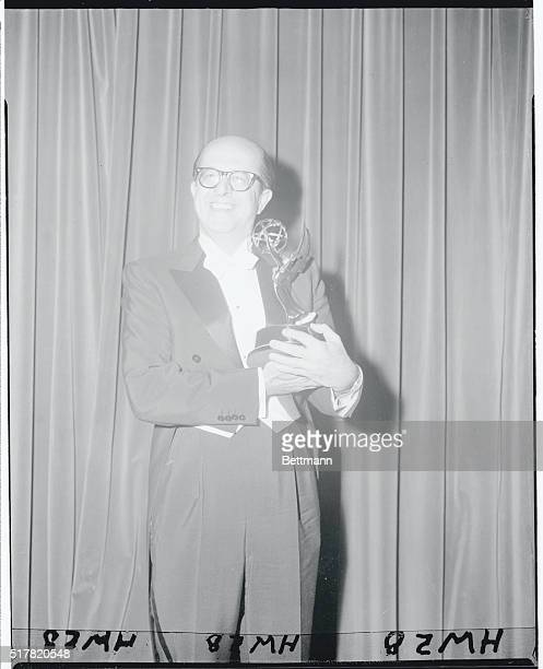 Bald bumptuous Phil Silvers the fast talking comedian garnered three Emmy Awards tonight at the eight annual awards ceremony of the Academy of...