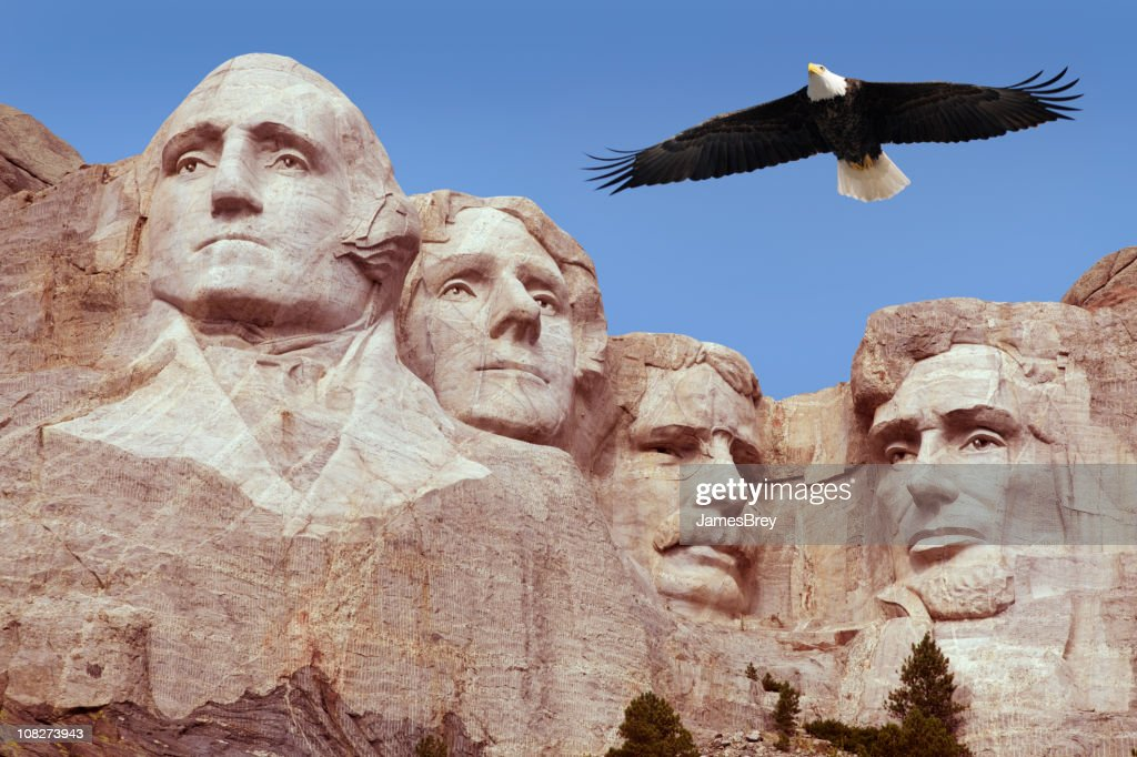 Bald Eagle Flying Free Above American Monument Mount Rushmore Presidents : Stock Photo
