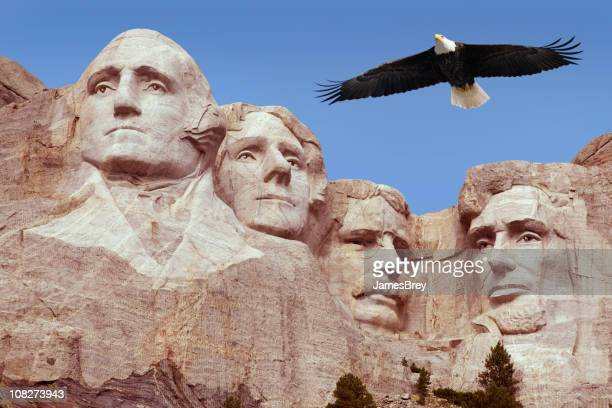 bald eagle flying free above american monument mount rushmore presidents - presidents day stock pictures, royalty-free photos & images