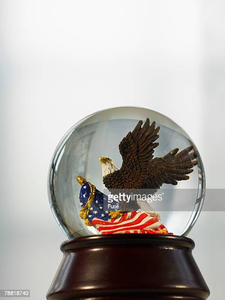 bald eagle snowglobe - bald eagle with american flag stock pictures, royalty-free photos & images