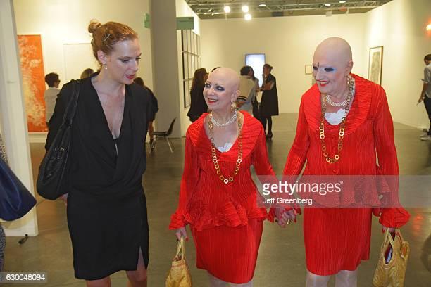 Bald hermaphrodite twins Evan Adele at the Art Basel event