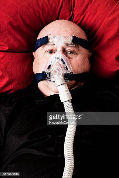 bald man awake with cpap mask - fat bald men stock pictures, royalty-free photos & images