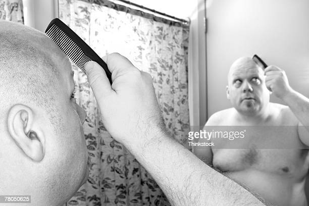 bald man combing his head - fat bald men stock pictures, royalty-free photos & images
