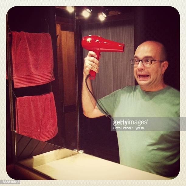 bald man grooming in bathroom - transfer image stock pictures, royalty-free photos & images