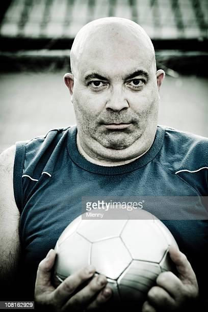 uomo calvo con pallone da calcio - fat soccer players foto e immagini stock
