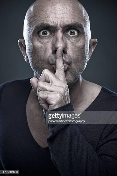 bald man intimating shut-up