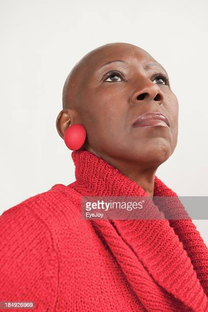 Bald Senior African American Woman Stands Proudly After Chemotherapy
