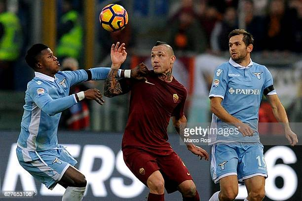 Balde Diao Keita and Senad Lulic of SS Lazio compete for the ball with ERadja Nainggolan of AS Roma during the Serie A match between SS Lazio and AS...
