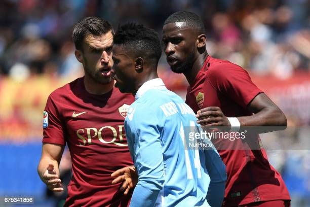 Balde Diao Keita of Lazio discussing with Kevin Strootman and Antonio Rudiger of Roma during the Serie A match between AS Roma and SS Lazio at Stadio...