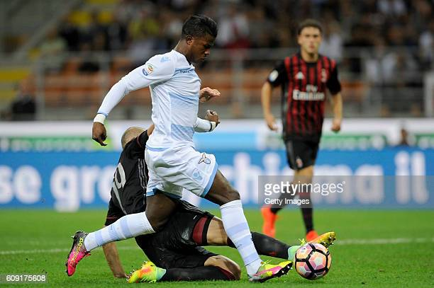 Balde Diao Keita of SS Lazio is tackled by Gabriel Paletta of AC Milan during the Serie A match between AC Milan and SS Lazio at Stadio Giuseppe...