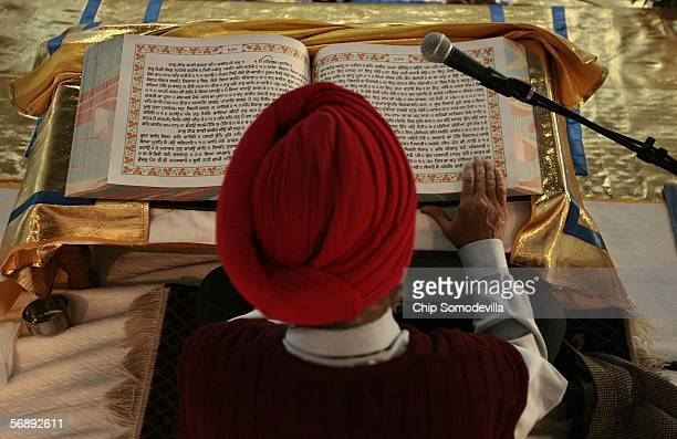 Baldev Singh recites from the Guru Granth Sahib the 1430page Sikh holy book during a 48hour nonstop reading at the new National Gurdwara or house of...
