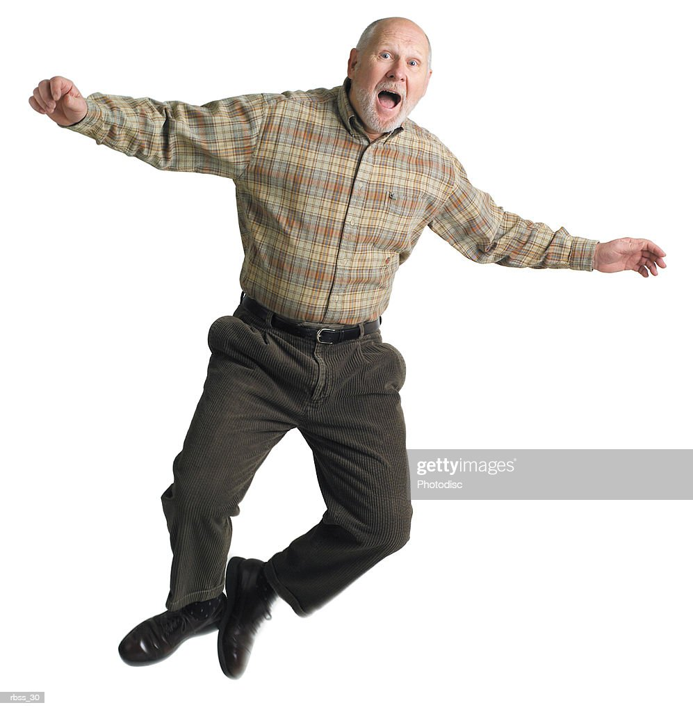 Balding elderly man jumps excitedly into the air. : Foto de stock