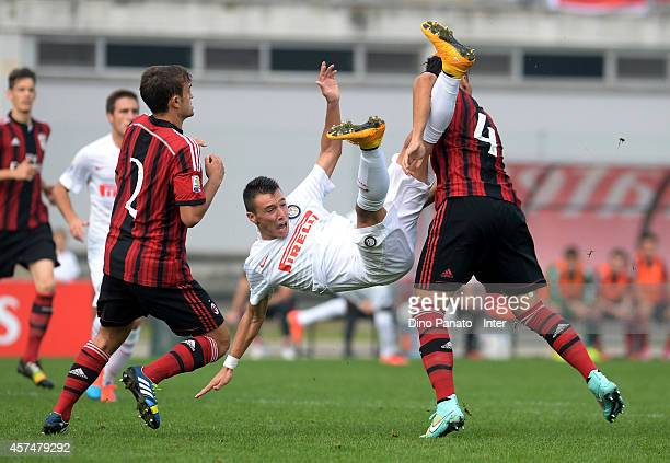 Baldini of Internazionale battles for tha ball with Turano and De Santis of Milan during the juvenile match between AC Milan and FC Internazionale on...