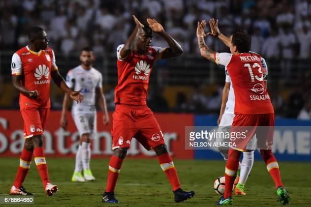 Baldomero Perlaza of Colombias Santa Fe celebrates with teammate Sebastian Salazar after scoring against Brazil's Santos during their 2017 Copa...