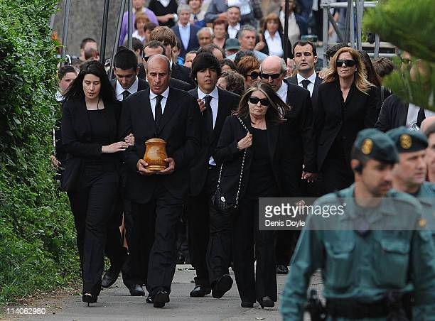 Baldomino Ballesteros carries the ashes of his brother Seve Ballesteros during the funeral service held for the legendary Spanish golfer on May 11...