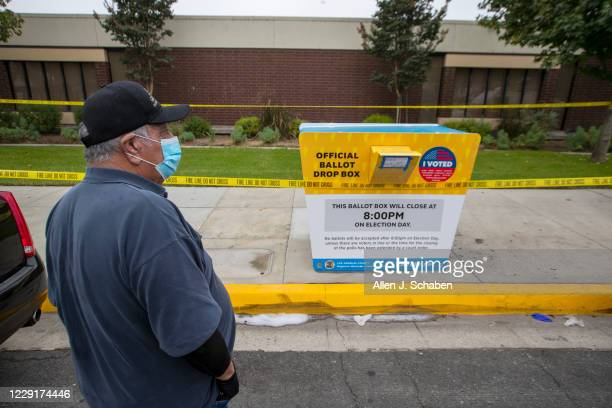 Baldwin Park resident John Rios, who dropped off his ballot at this official ballot drop box recently, stopped by to view the fire damage and see if...