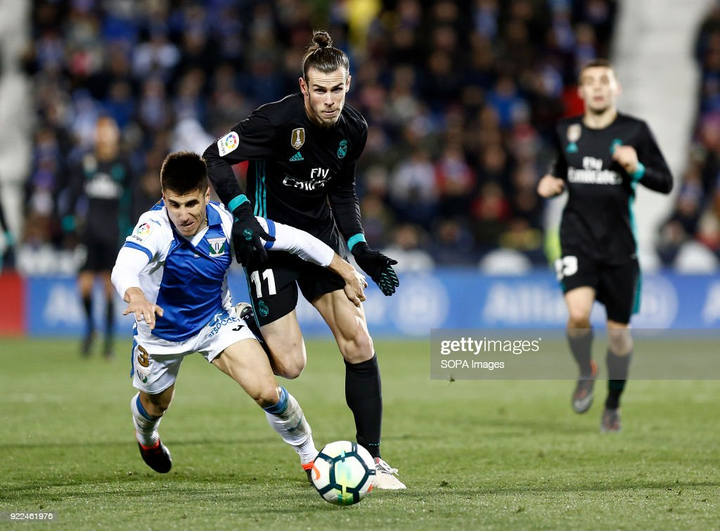 BUTARQUE, LEGANES, MADRID, SPAIN - : Bale (Real Madrid) competes for the ball with Bustinza of during the match between Leganes vs Real Madrid at the Estadio Butarque. Final Score Leganes 1 Real Madrid 3.