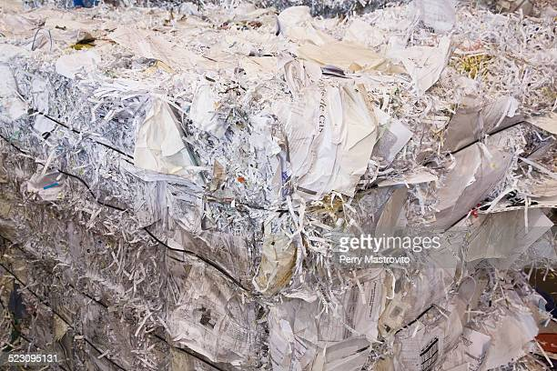 Bale of recyclable shredded office paper at a sorting centre, Quebec, Canada