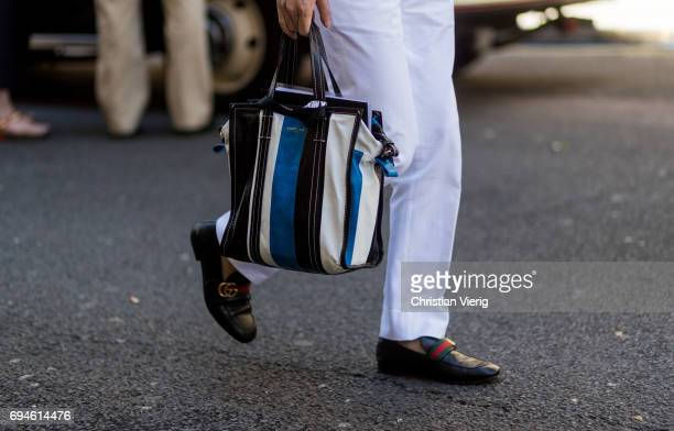 Balenciaga bag and Gucci shoes during the London Fashion Week Men's June 2017 collections on June 10 2017 in London England