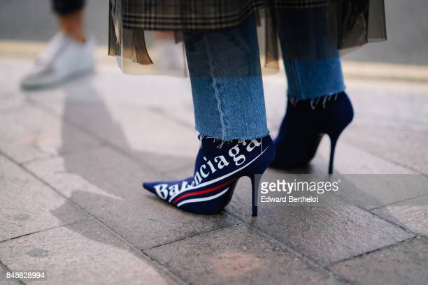 Balenciaga shoes are seen outside Versus during London Fashion Week September 2017 on September 17 2017 in London England