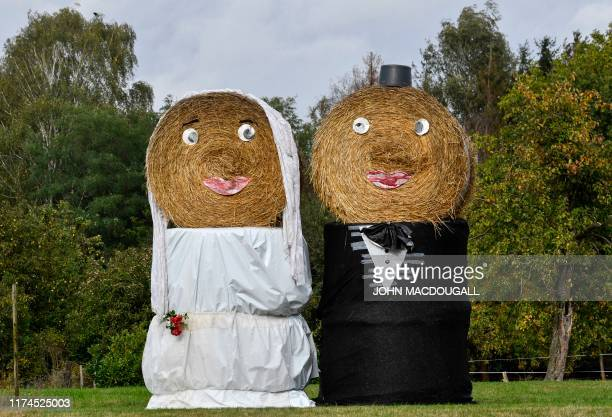 Bales of hay are dressed up as a bride and groom in the village of Schmarsau in Loewr Saxony on October 8 2019