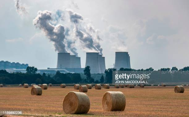 Bales of hay lie in front of the Jaenschwalde Power Station near Peitz taken on July 30 2019 The thirdlargest brown coal power plant in Germany that...