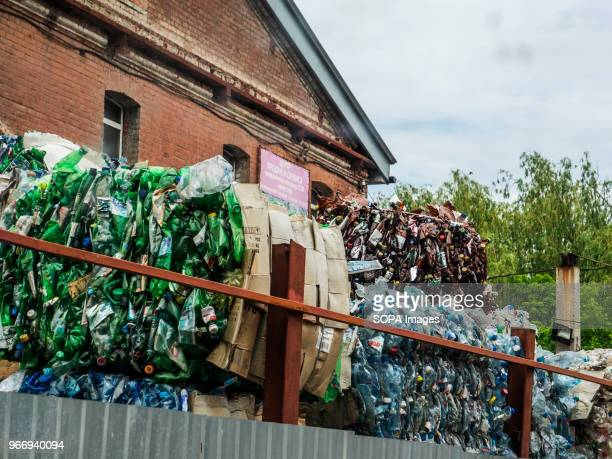 Bales of recycled used bottles piled up high In Ukraine enterprises for the processing of domestic waste are actively developing Several such...
