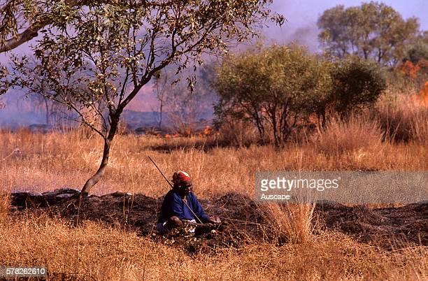 Balgo woman hunting waterholding frogs Balwina Aboriginal Land southeast Kimberley region Western Australia Australia