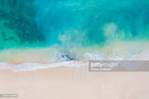 bali, aerial view of a beach - blue transparent ocean and white sand. - clear sky stock pictures, royalty-free photos & images
