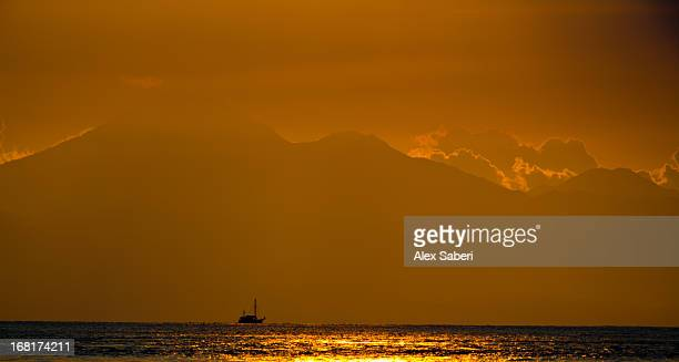 bali in the distance with mount agung from gili trawangan. - alex saberi stock pictures, royalty-free photos & images