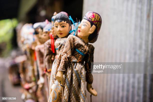 Bali Indonesia Hand Carved Wooden Puppets Displayed in Gitgit