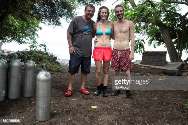 Roni a tourist from Brazil with his two friends still brave have diving session at Tulamben which is one of the red zone area if Mount Agung hardly...