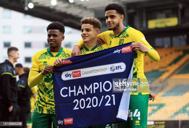 Bali Mumba, Max Aarons, and Andrew Omobamidele of Norwich City celebrate winning the Sky Bet Championship after the Sky Bet Championship match...