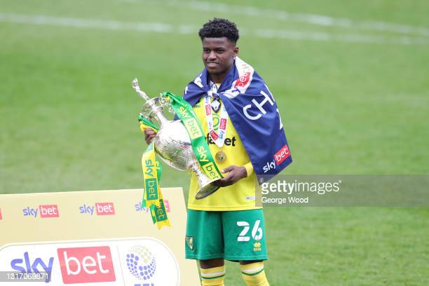 Bali Mumba of Norwich City celebrates with the Sky Bet Championship trophy following the Sky Bet Championship match between Barnsley and Norwich City...
