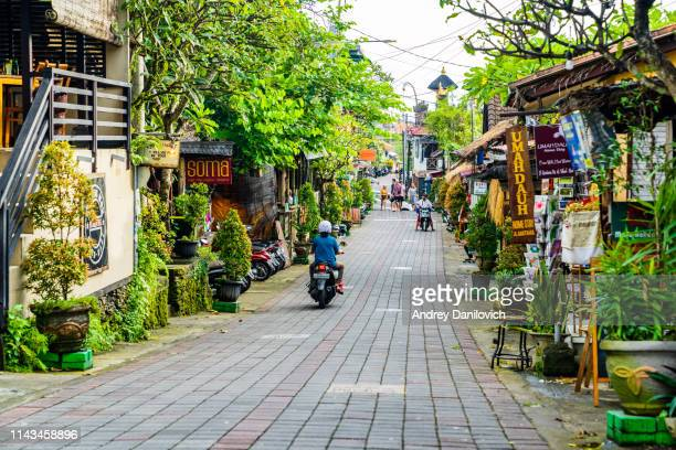 bali, one of the central streets of ubud, full of bars, restaurants and stores. - bali stock pictures, royalty-free photos & images