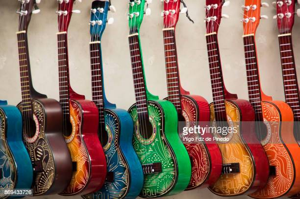 bali souvenir - wooden guitars - ubud - bali - indonesa. - customised stock pictures, royalty-free photos & images