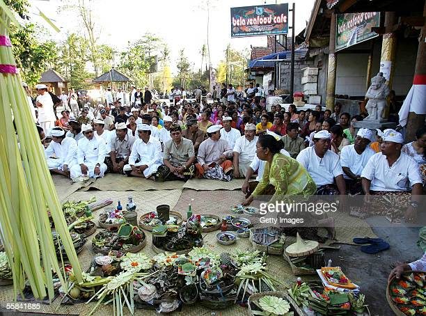 Balinese cafe owners workers and local community members pray at a Cleansing ceremony after the suicide bomber attacks October 3 2005 in Bali...