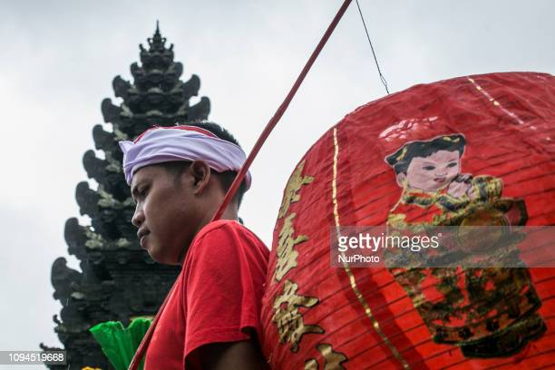 Balinese carries paper lantern during Balingkang Kintamani Festival parade to celebrate Chinese New Year and also to introduce the acculturation of...