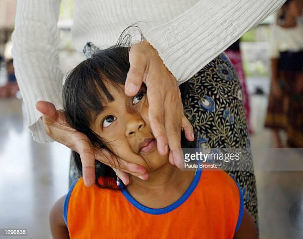 Balinese Dance teacher Ida Ayu Sasih shows a young female student proper head movements August 6,2002 in Amlapura, Bali, Indonesia during a...