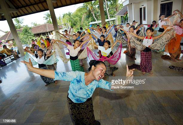 Balinese dance teacher Ni Made Kinten demonstrates the dance form to young female students August 62002 in Amlapura Bali Indonesia during a Legong...