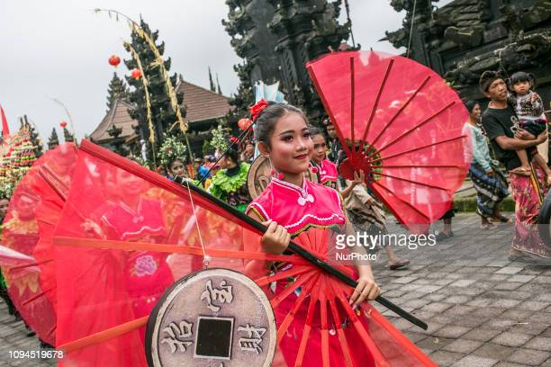 Balinese dress in Chinese traditional costume take parts during Balingkang Kintamani Festival parade to celebrate Chinese New Year and also to...