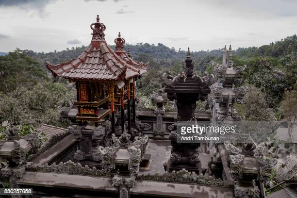 Balinese family temple is seen covered by a layer of ash spewed by Mount Agung eruption on November 27 2017 in Karangasem Island of Bali Indonesia...