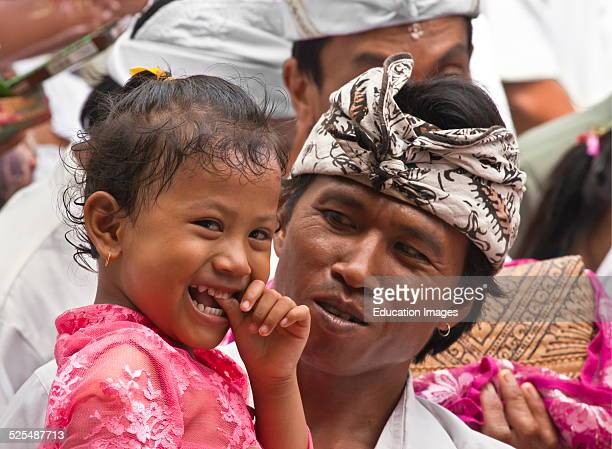 A Balinese Father And Daughter At Pura Beji In The Village Of Mas During The Galungan Festival Ubud Bali Indonesia