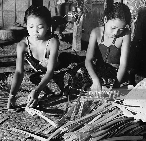 Balinese girls learn to plait pandanus leaves from an early age Everything from flooring mats and partitions to baskets and hats are produced in this...